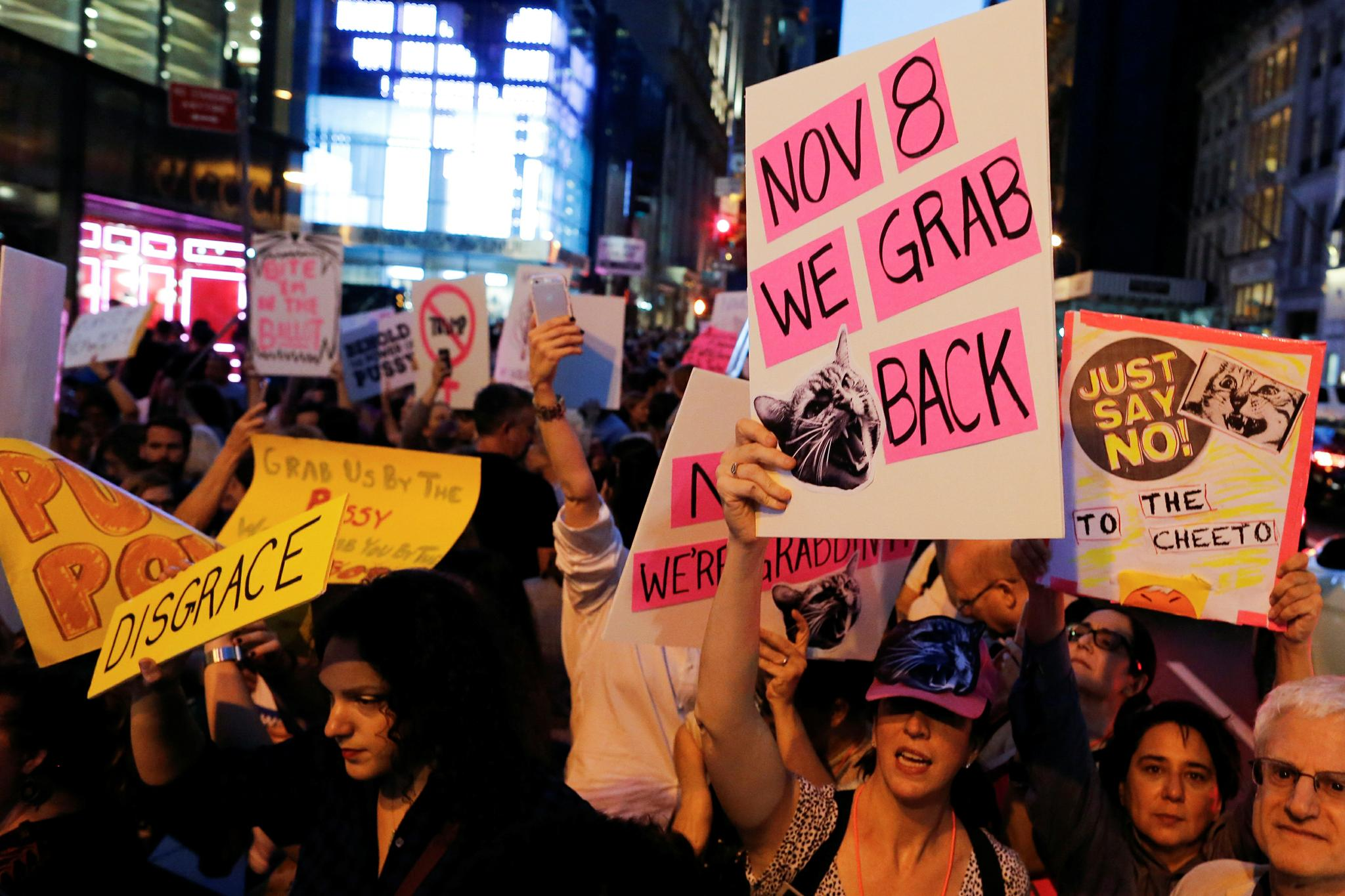 Women protest against Republican presidential nominee Donald Trump and the GOP in front of Trump Tower in New York, New York, October 19.