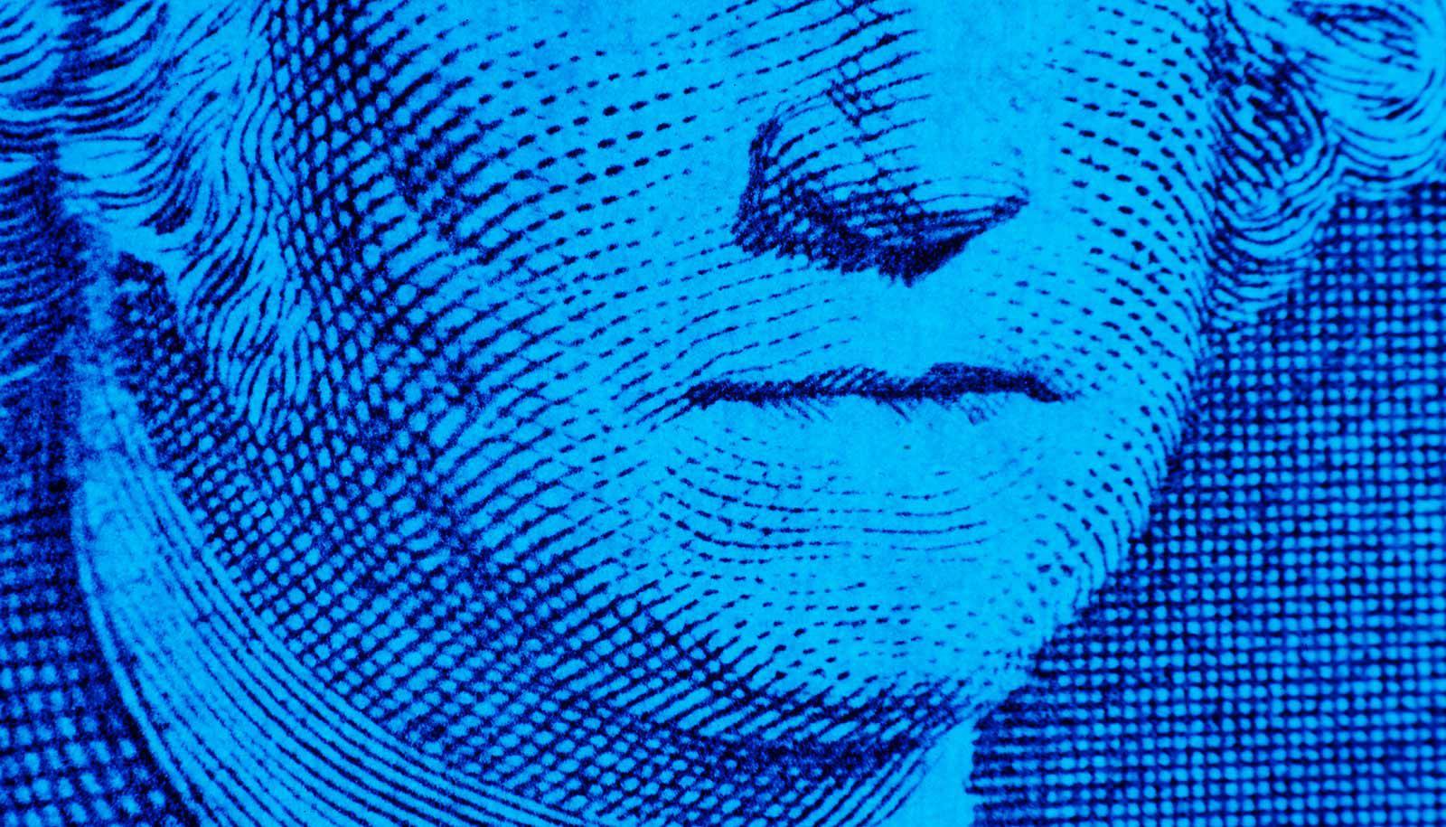 Washington's closed mouth on dollar bill -- blue filter