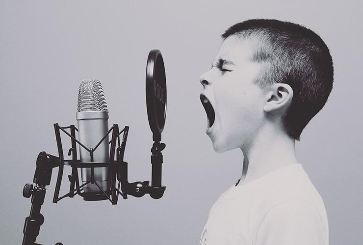 Building a Bridge Between Your Personal Voice and Your Spirituality by Scott Matthews. Photograph of a child yelling into a microphone by Jason Roswell