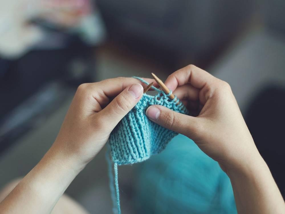 close up of a person knitting