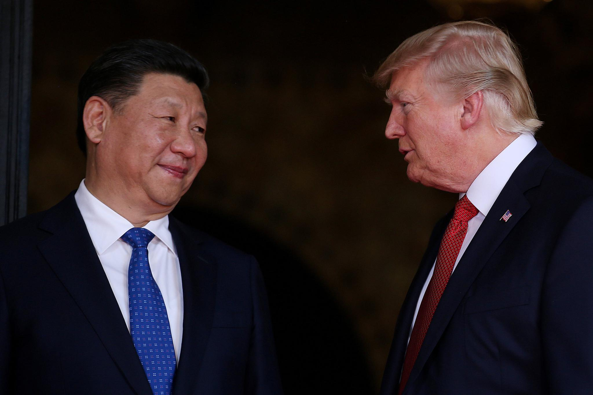 U.S. President Donald Trump welcomes Chinese President Xi Jinping at Mar-a-Lago state in Palm Beach, Florida, on April 6. A report claimed that China has killed or imprisoned multiple U.S. spies in recent years.