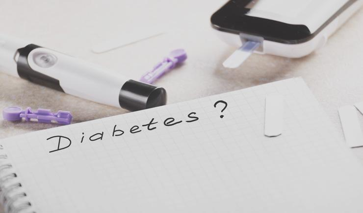 Diabetes: Why It's Often Undiagnosed, Symptoms to Look for and What You Can Do, by Kristin Fuller. Photograph of pad with word Diabetes in ink and testing apparatus.