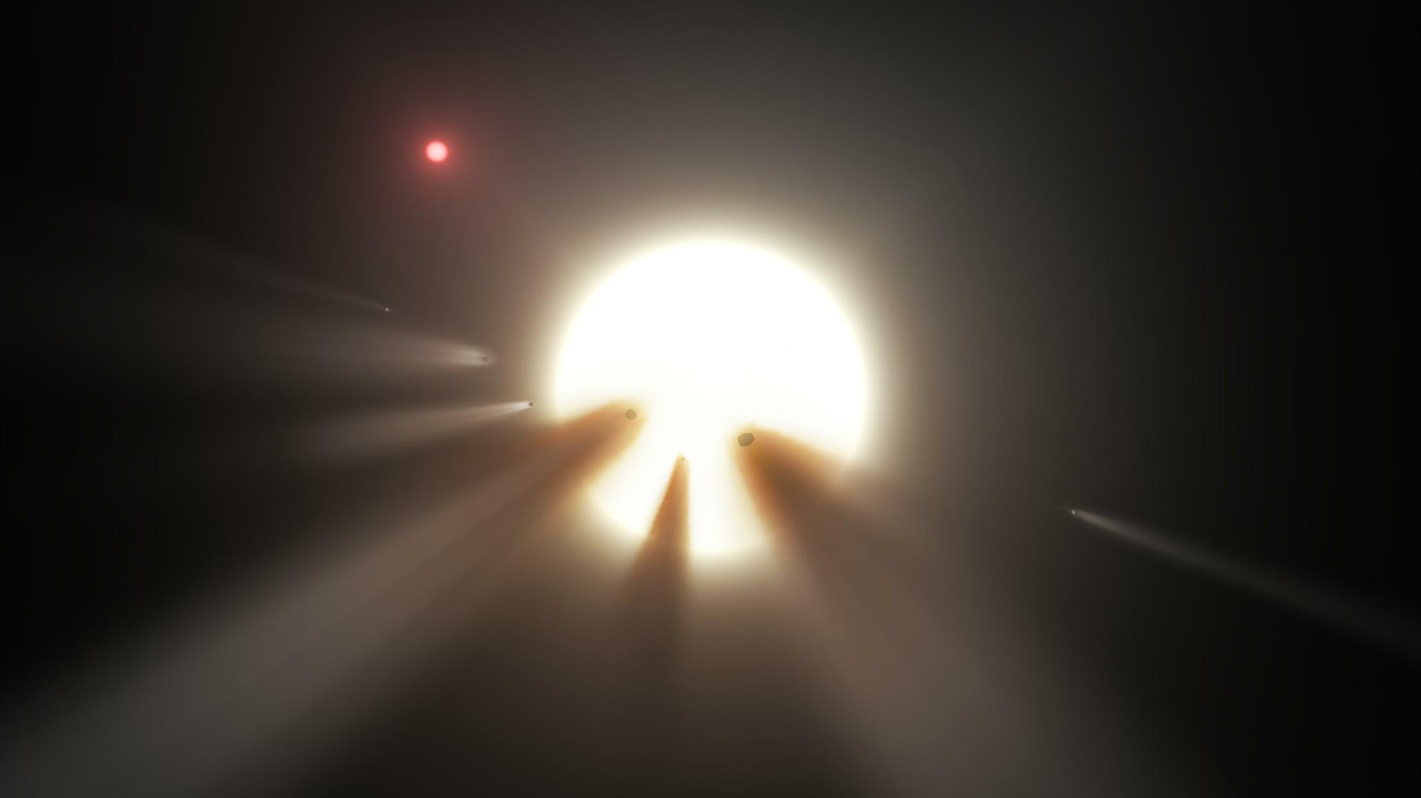 The weird light blips coming from this star might be caused by a family of comets or collision debris, but scientists don't really know.