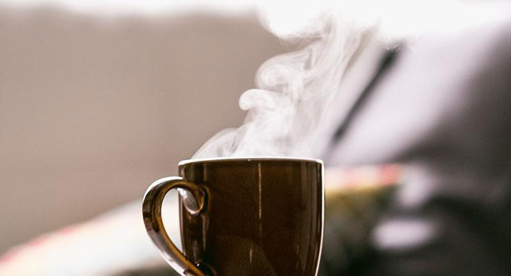 Have A Fantastic Day: A Morning Routine that Sets You Up For Success by Sharon Hooper. Photograph of a steaming cup of coffee by Tim Foster