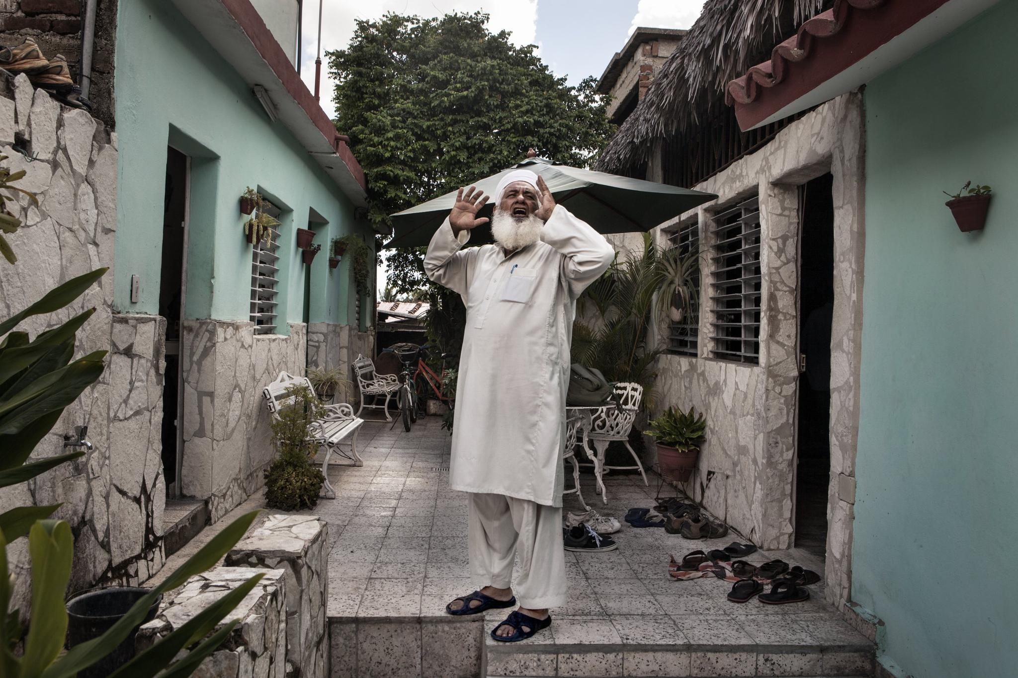 Juan Enriquez, 70, became known by his Muslim name, Yahya, after he converted to Islam in 2007. Here, he calls to Friday's prayer in the mosque of Camagüey, which was built inside a private home to avoid problems with the Cuban authorities.