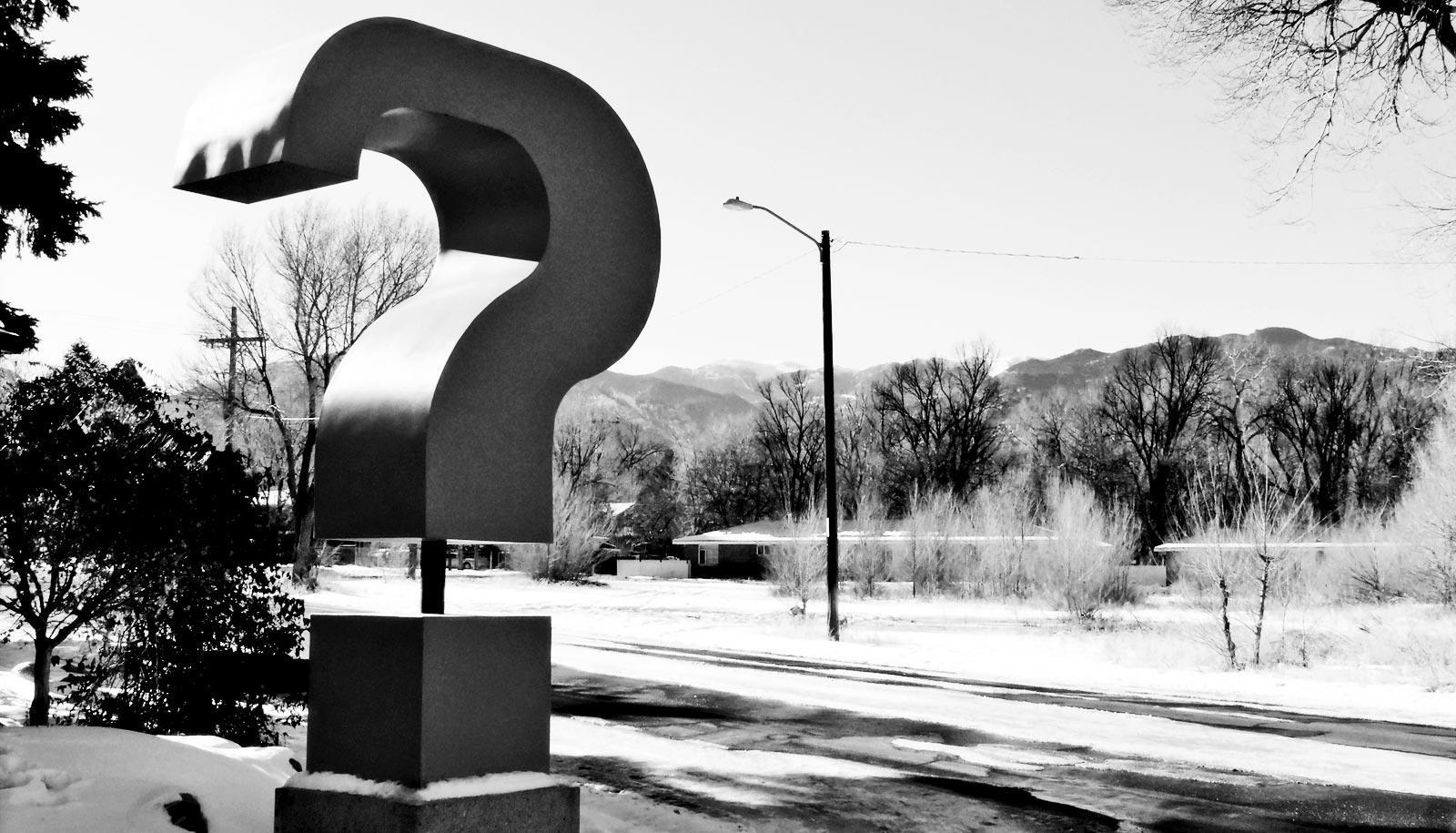 question mark on the side of the road (autonomous robots concept)