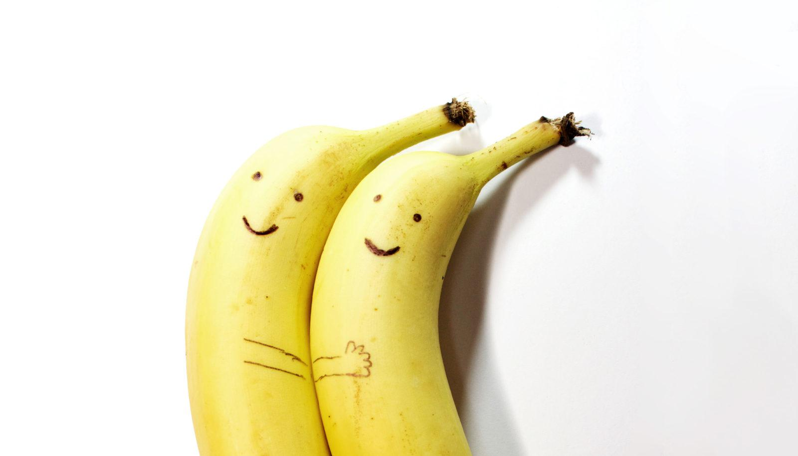 pair of spooning bananas with nice faces