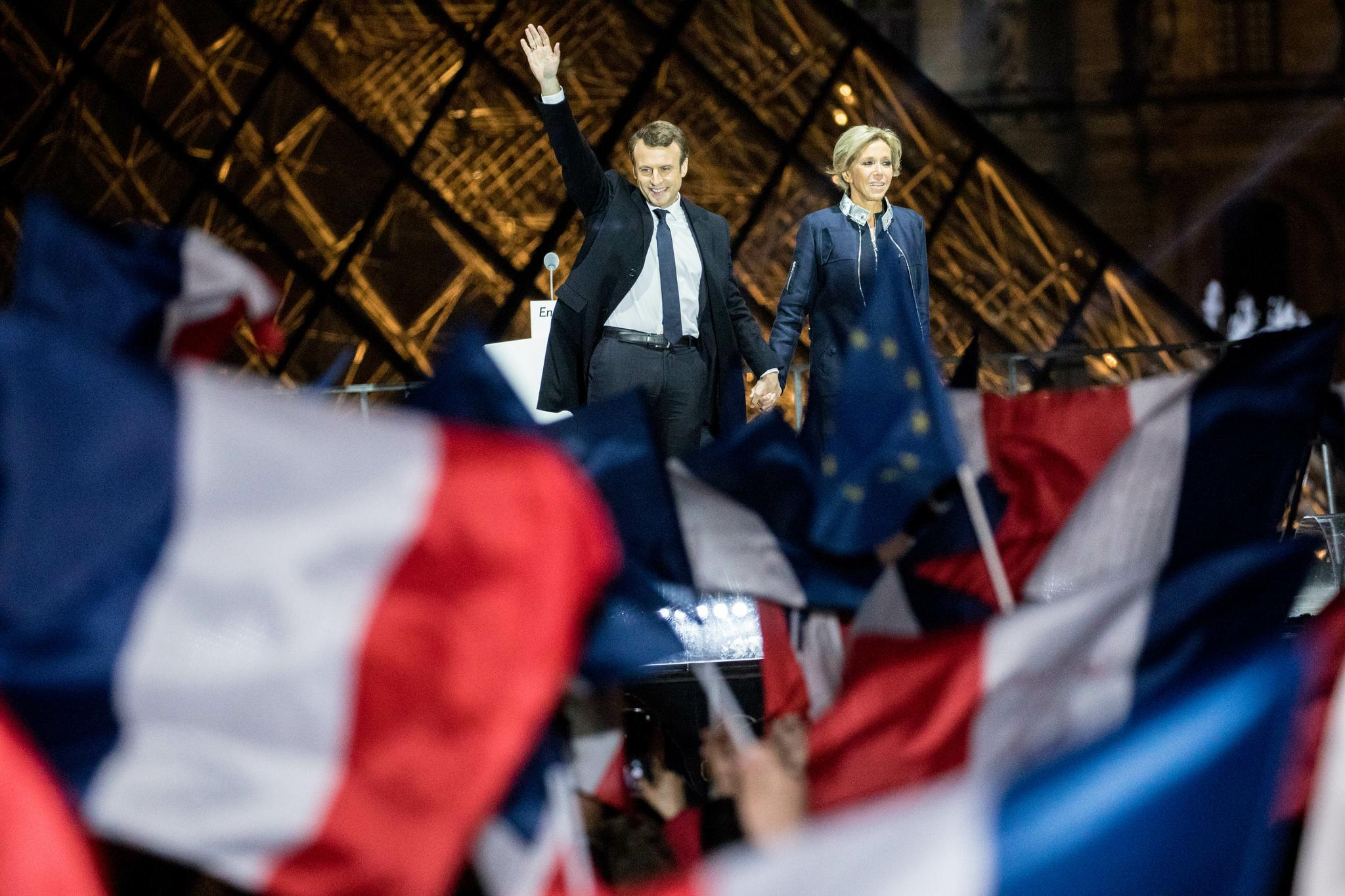 French president-elect Emmanuel Macron waves to the crowd at the Pyramid at the Louvre Museum in Paris on May 7. Emmanuel Macron was elected French president in a resounding victory over far-right National Front rival Marine Le Pen after a deeply divisive campaign.