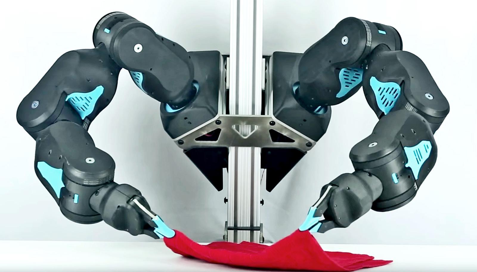 Blue robot arms folding laundry
