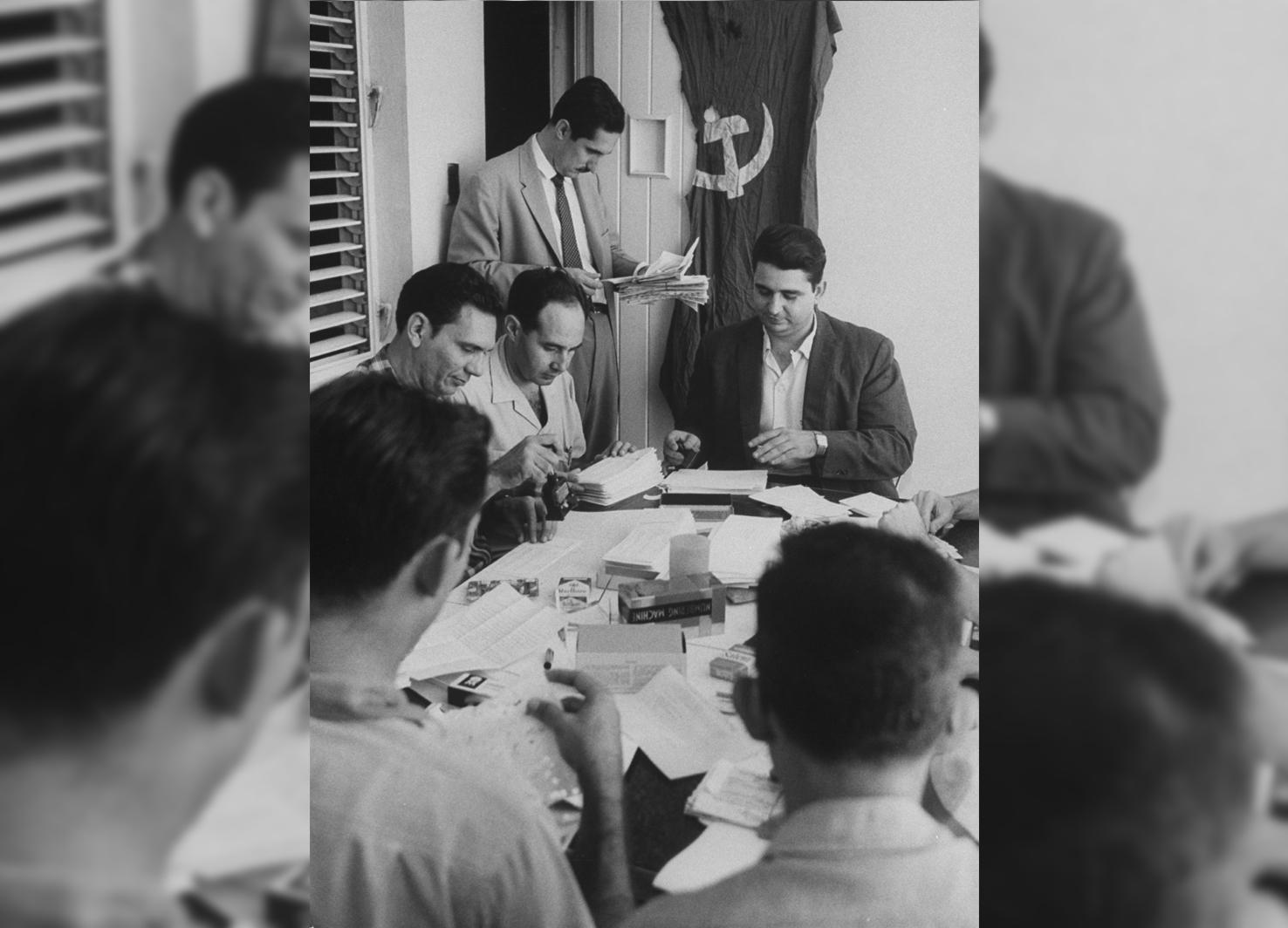 Antonio Veciana stands in a meeting with members of the anti-Castro action group Alpha 66, on October 1, 1962.