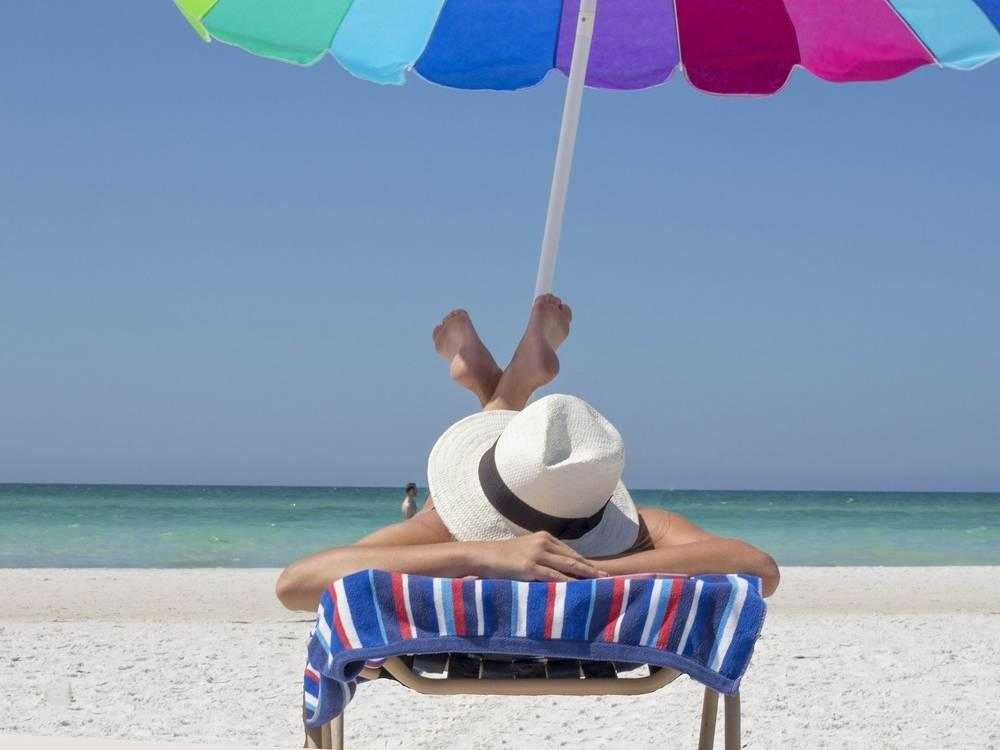 a person laying out on the beach