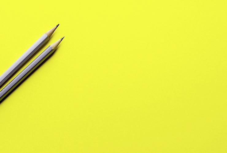 Blissing Out: A Writer's Journey to Finding her Life Passion (and Tips for Finding Yours) by Diana Raab. Photograph of two pencils on a blank yellow canvas by Joanna Kosinka