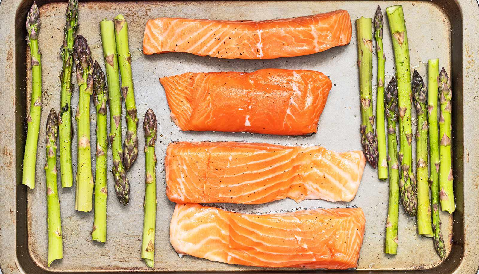 salmon pieces and asparagus on sheet pan