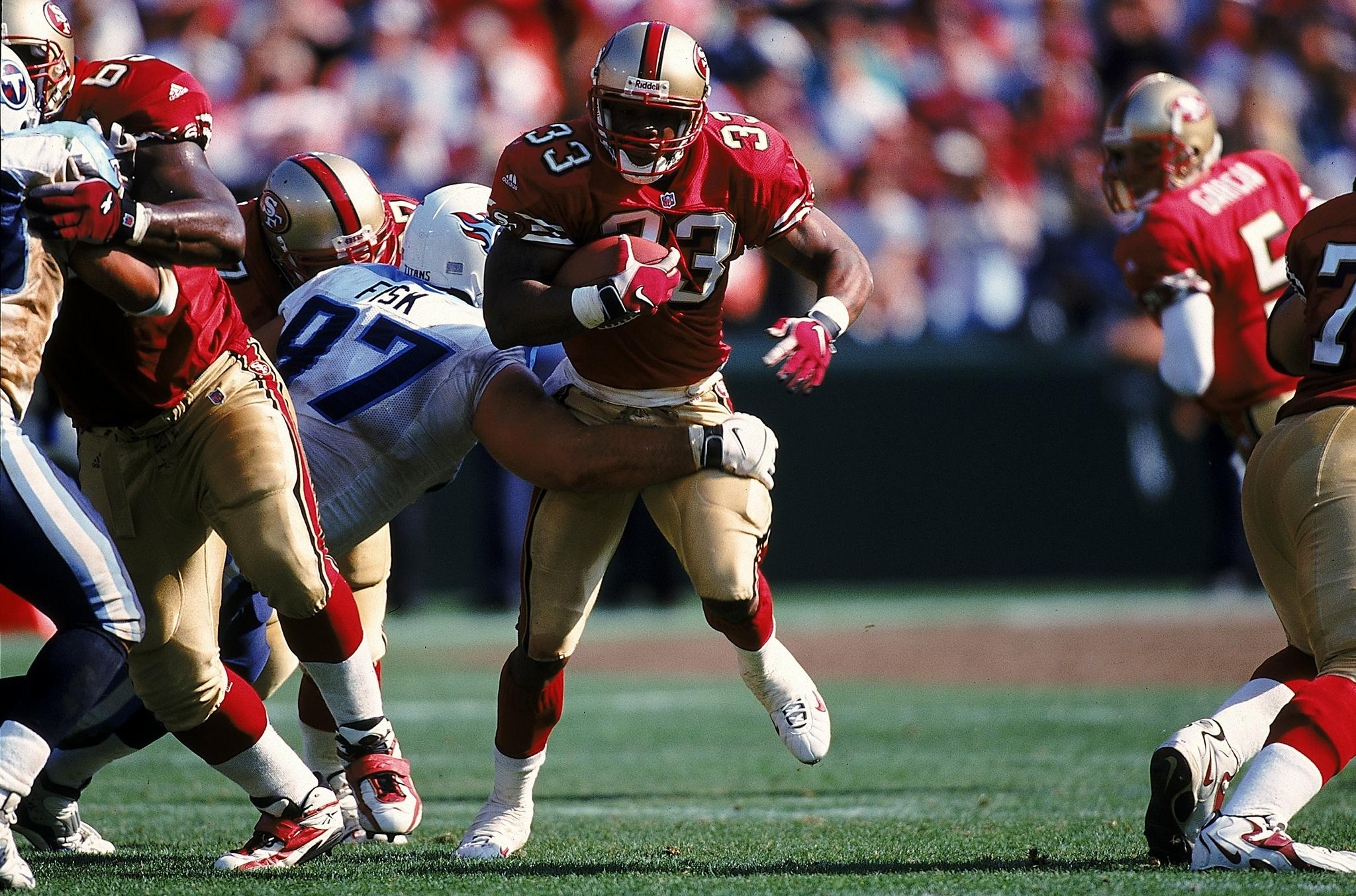 Lawrence Phillips of the San Francisco 49ers carries the ball during a game against the Tennessee Titans at 3Com Park in San Francisco, California on October 3, 1999.