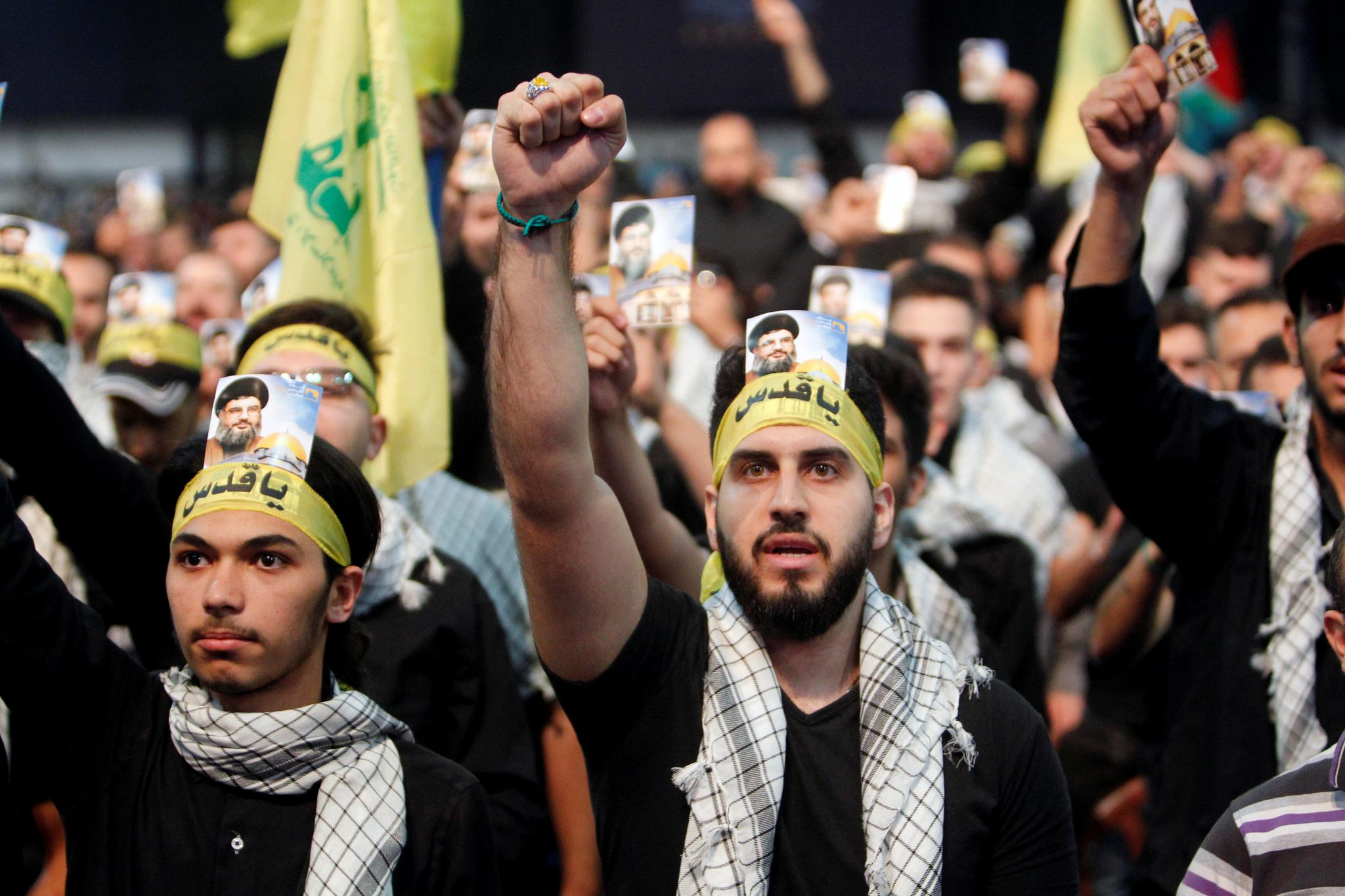 Supporters of Lebanon's Hezbollah leader Sayyed Hassan Nasrallah chant slogans and gesture during a rally marking Al-Quds day in Beirut's southern suburbs in Lebanon on June 23.