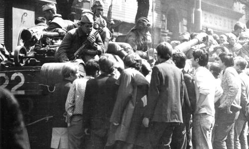 Young Czechs crowd around to talk to soldiers.