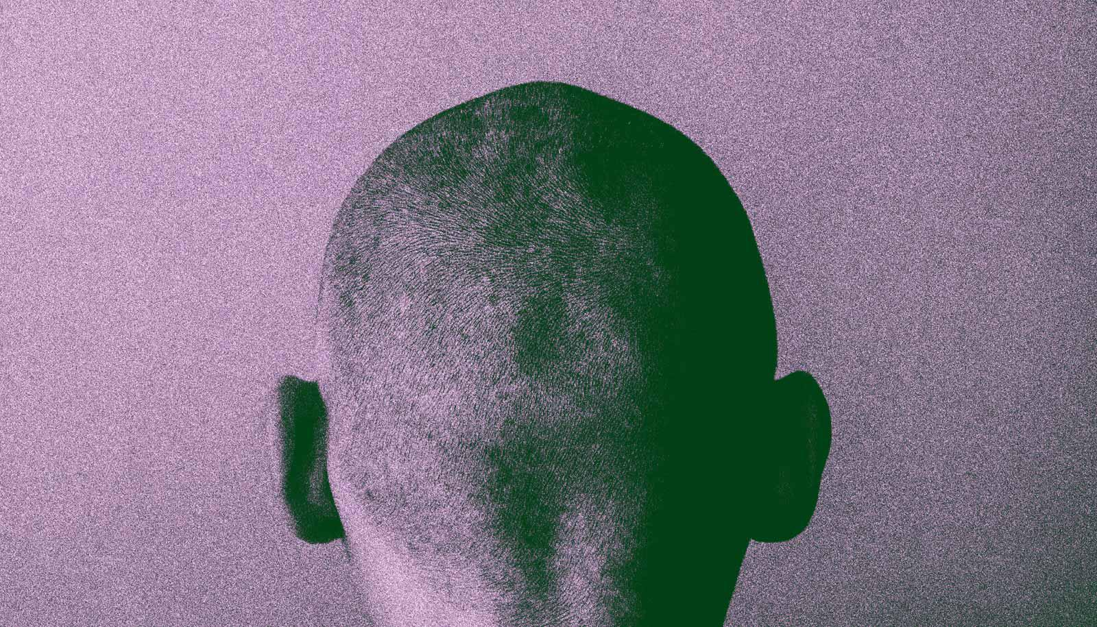 purple grainy shot of back of man's head