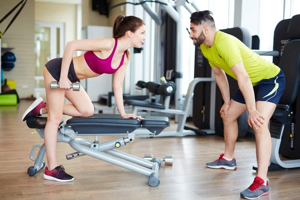 two people flirting in a gym