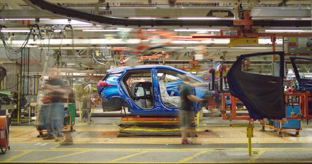Factory worker in a car assembly line.