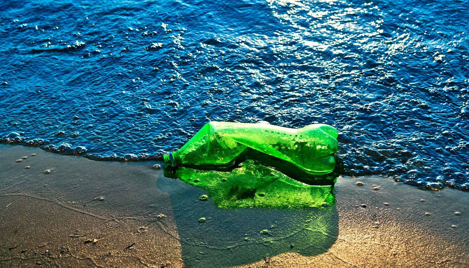 plastic bottle on the beach (plastic concept)