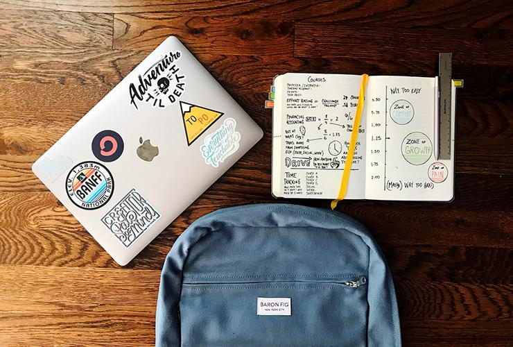 7 Esssential Healthy Living Tips for College Students by Jenine Wingg. Photograph of a laptop, book bag and journal by Matt Ragland