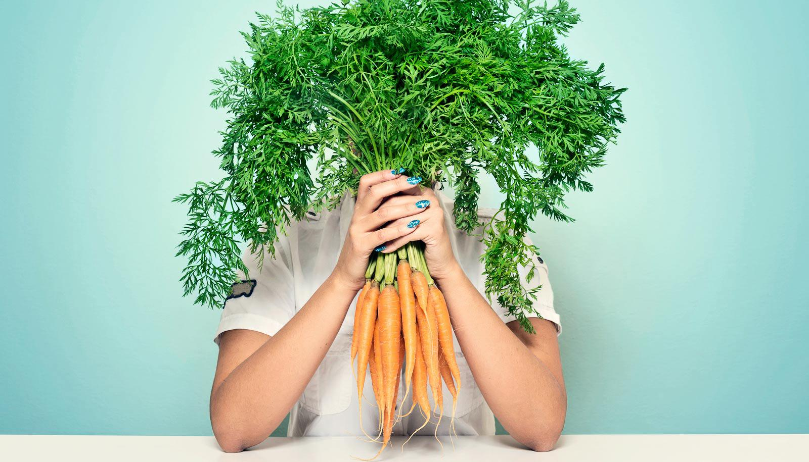 carrots in front of face
