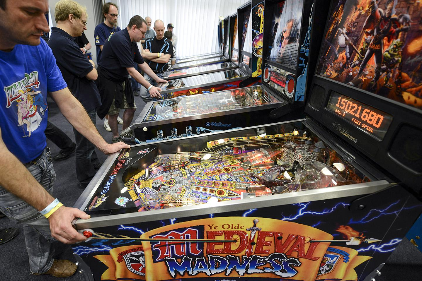 Competition participants play pinball during the open German pinball championships in Nuremberg, Germany, 24 May 2014.