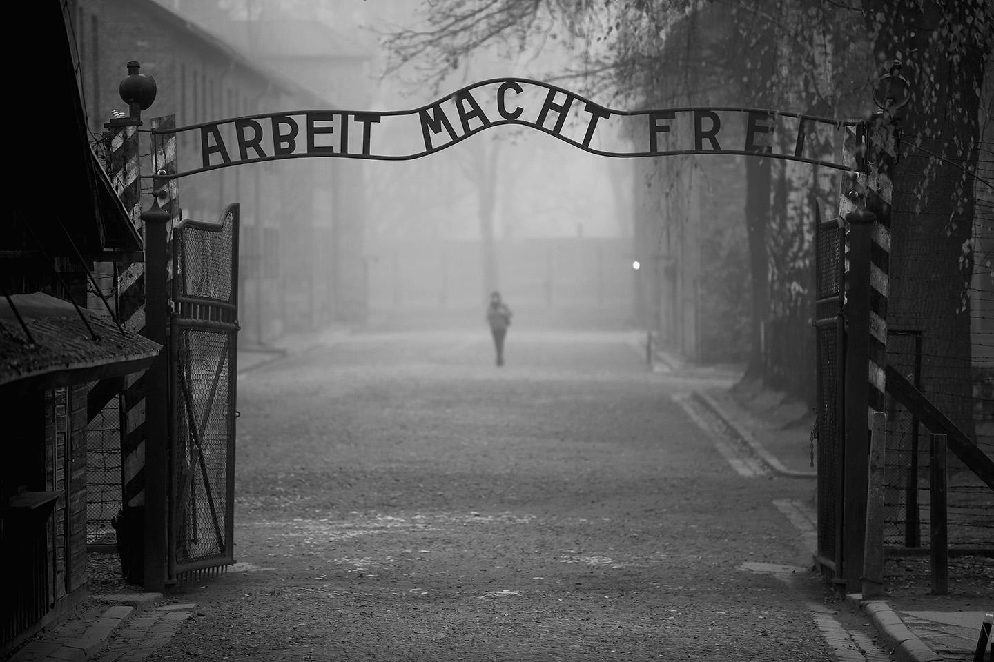 "The infamous sign at the main gate of the Auschwitz extermination camp reads ""Work Makes You Free,"" in Oswiecim, Poland, on November 15, 2014."