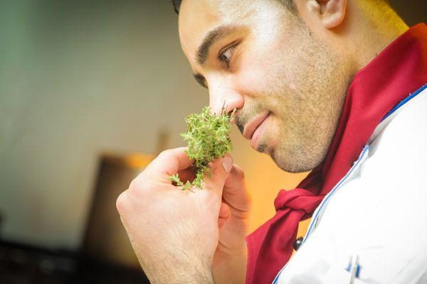 chef sniffing rosemary
