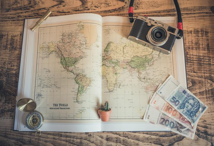 Explore More: Tips To Travel Abroad On A Budget, by Paisley Hansen. Photograph of world map by Chris Lawton