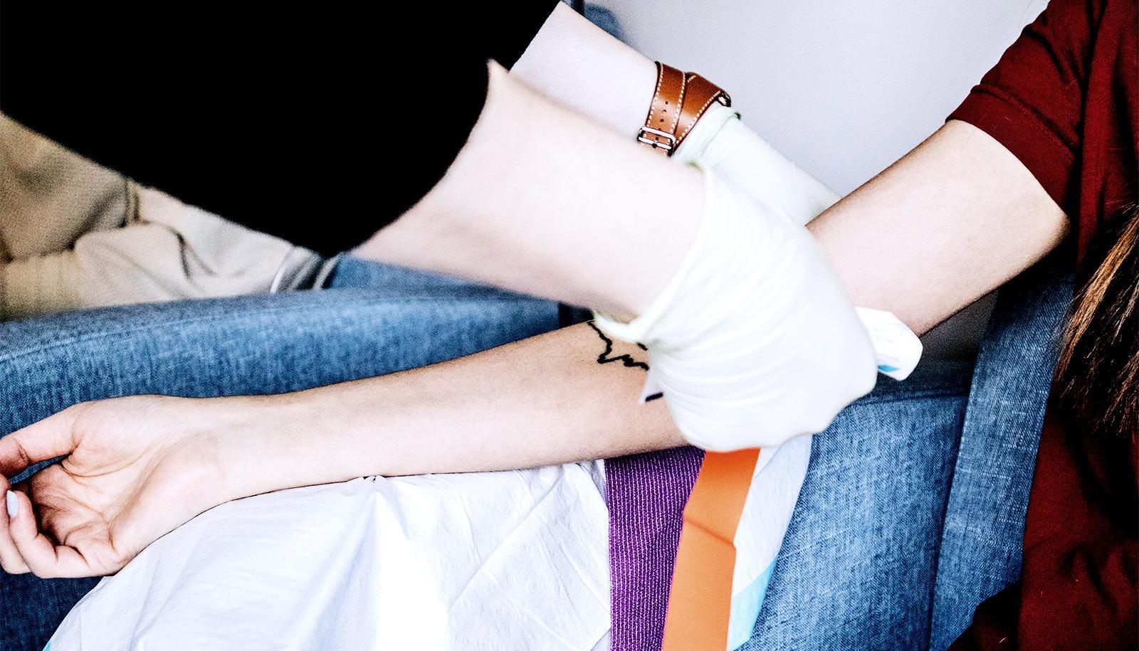 A woman gets a blood test