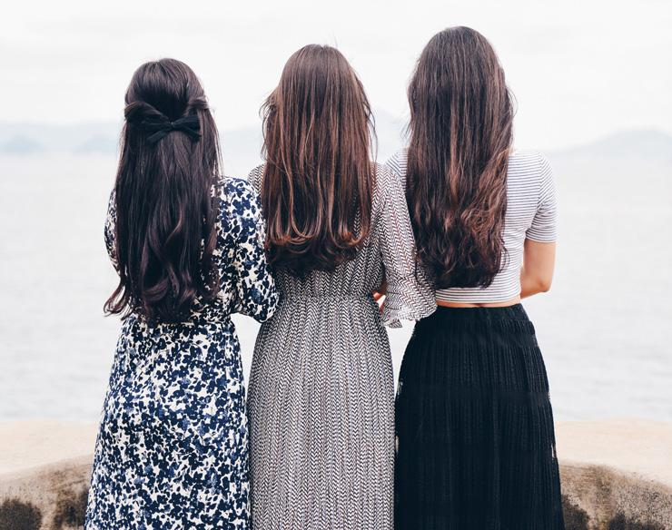 A Call for Women to Redefine Self-Care by Taking Care of Your Finances, by Sweta Vikram. Photograph of 3 women from behind by Suhyeon Choi