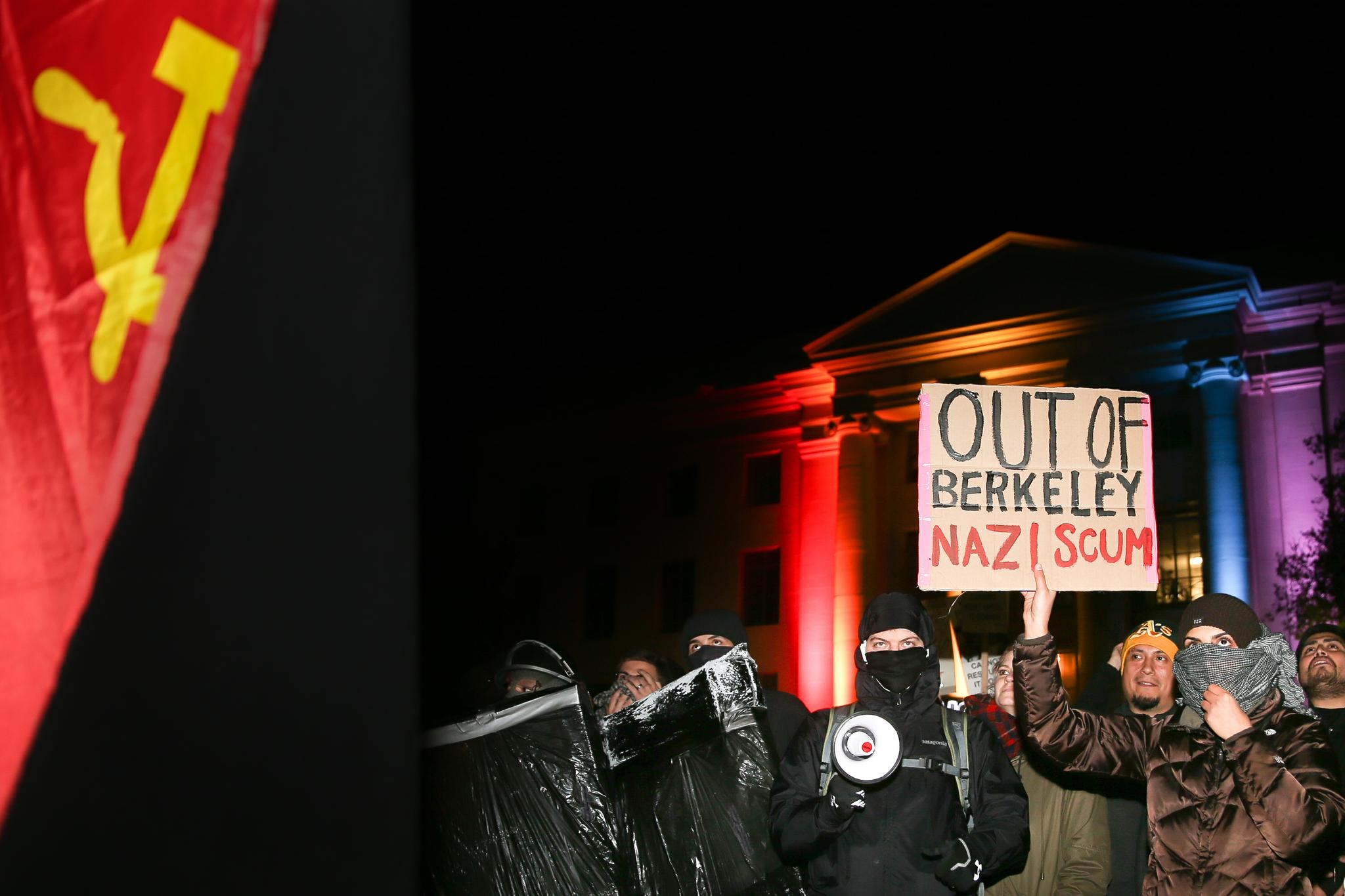 People protest controversial Breitbart writer Milo Yiannopoulos at UC Berkeley on February 1. A scheduled speech by Yiannopoulos was canceled after the protests became violent.