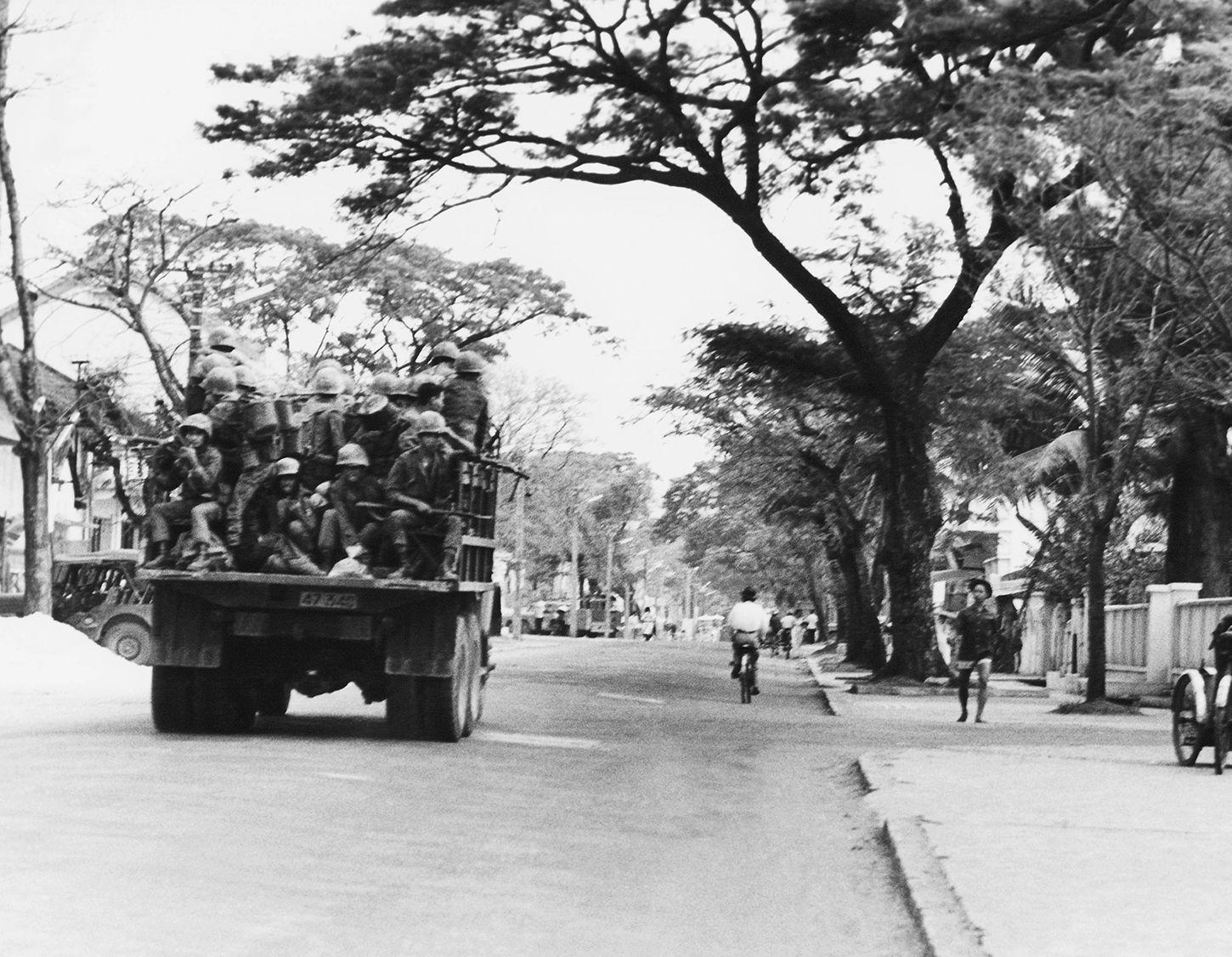 A truckload of Vietnamese soldiers loyal to then-Premier Ky moves through a Danang street, May 15, 1966. An airlift brought some 2,500 troops to take control of radio station, city hall and other strategic areas.