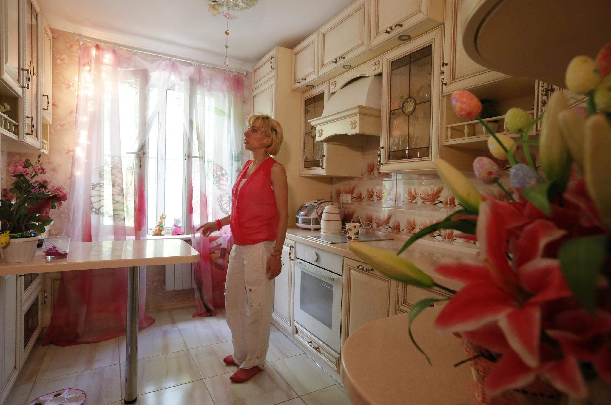 Anti-demolition activist Kari Guggenberger shows the kitchen of her apartment in a building to be demolished under the city authorities' renovation plan, in Moscow, Russia, on May 7, 2017.