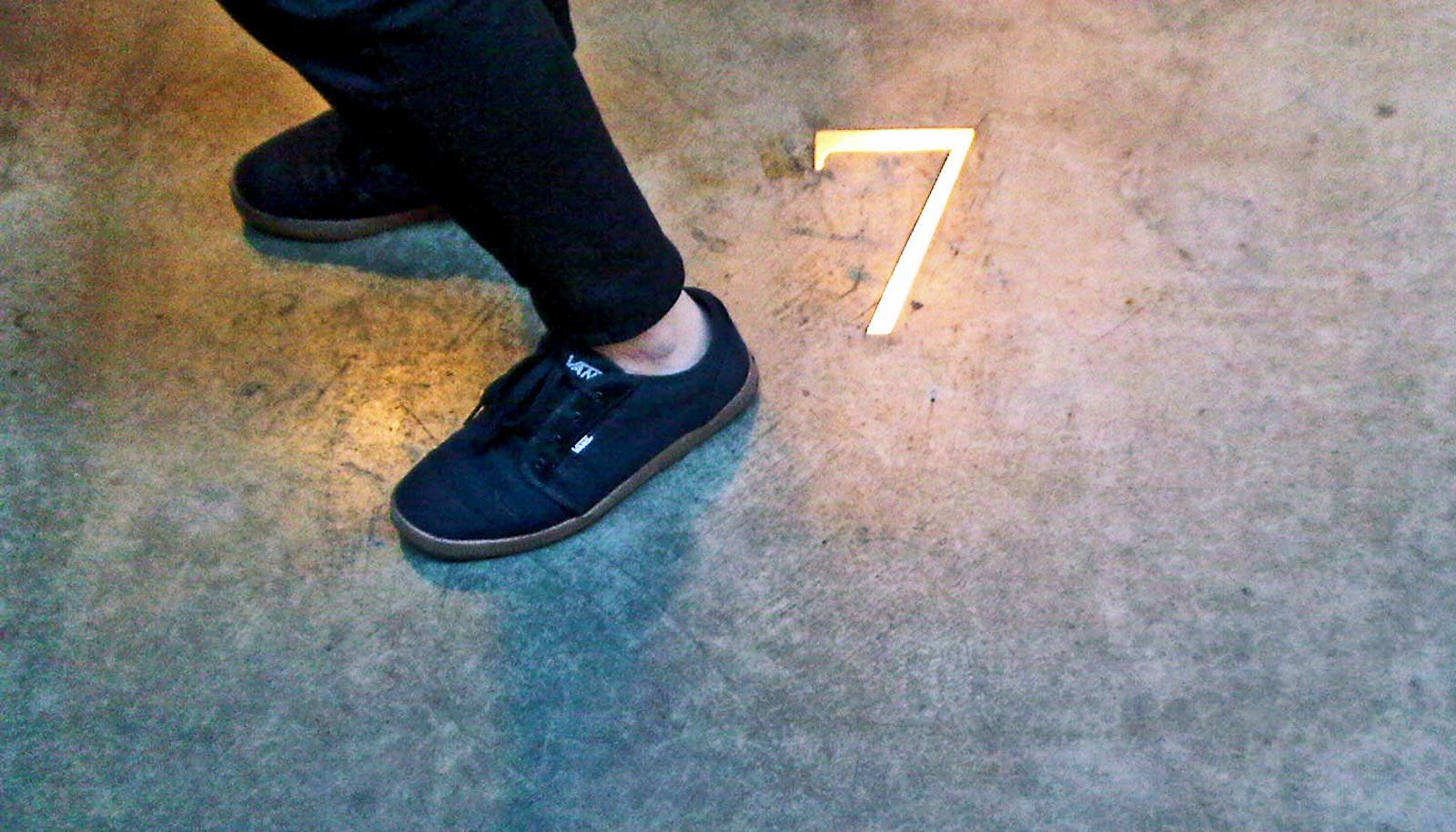 heart disease risk: feet by number 7 on cement floor
