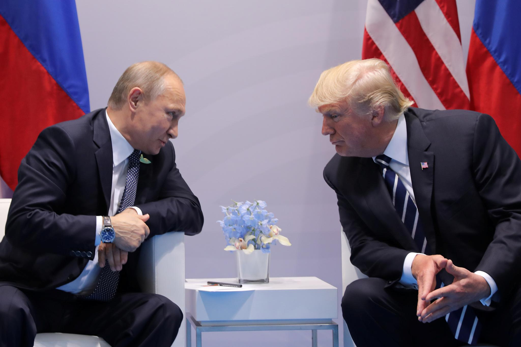 Russia's President Vladimir Putin talks to U.S. President Donald Trump during their bilateral meeting at the G-20 summit, in Hamburg, Germany. Forget collusion. U.S. counterspies worry the president has—wittingly or unwittingly—become a Kremlin 'asset.'
