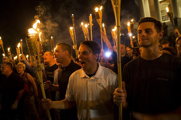 White supremacists encircle and chant at counter-protesters after marching through the University of Virginia campus with torches in Charlottesville, Virginia, on Aug. 11. (Samuel Corum/Anadolu Agency/Getty Images)