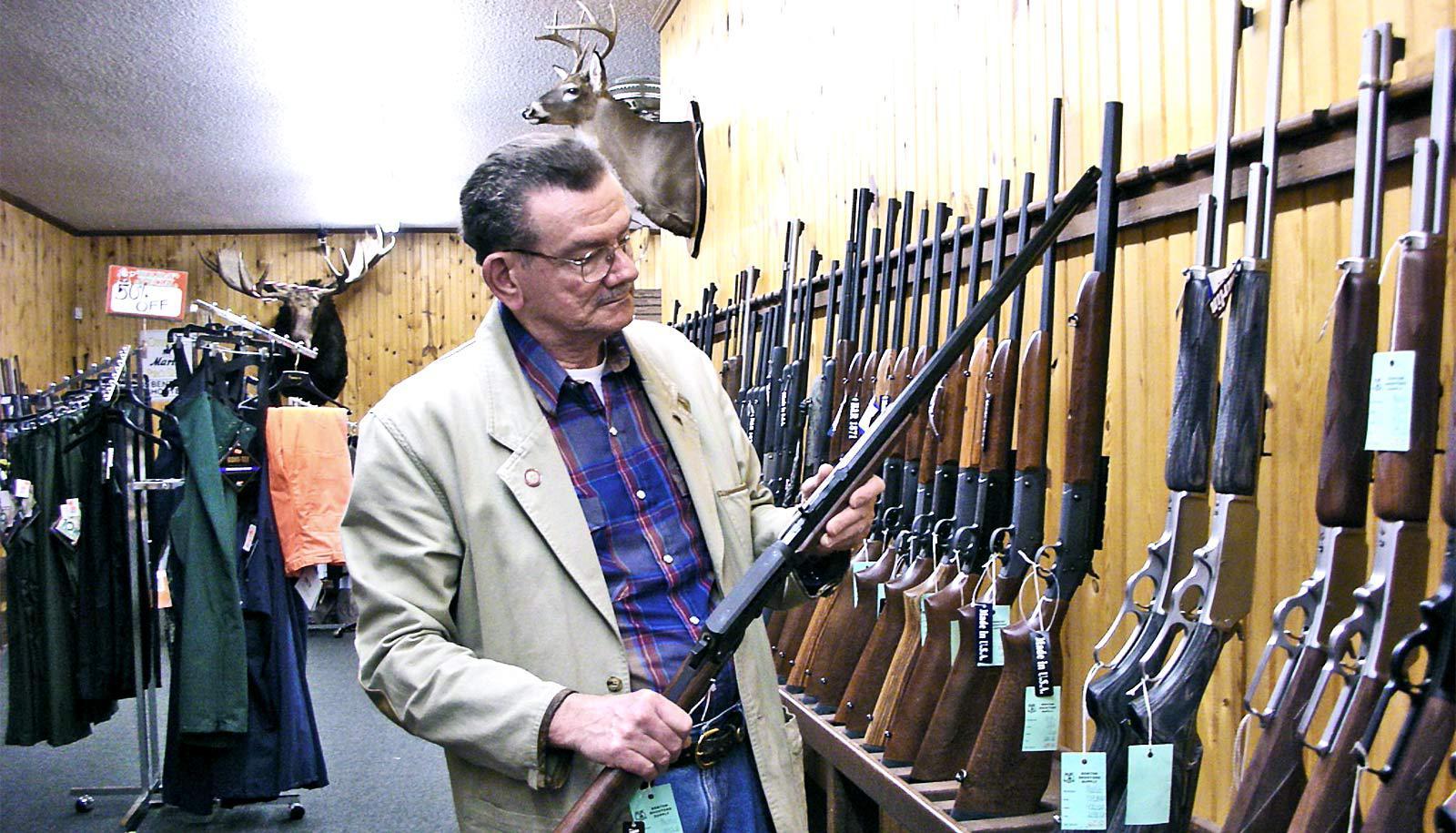 buying a gun (gun sales concept)