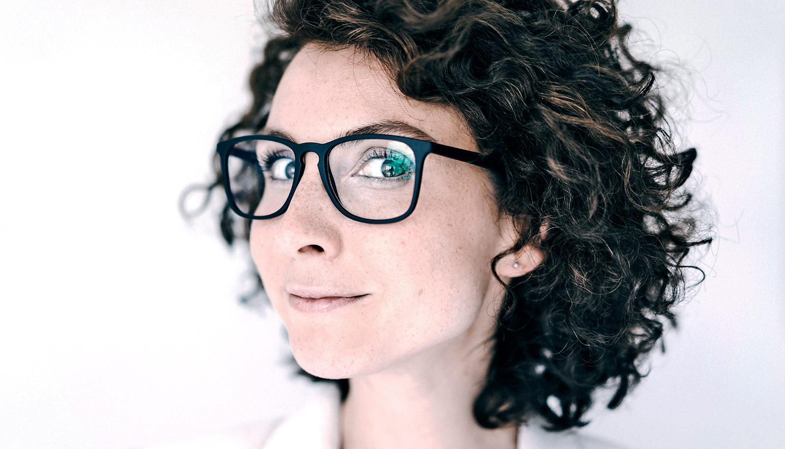 woman with glasses and curly hair (brains concept)