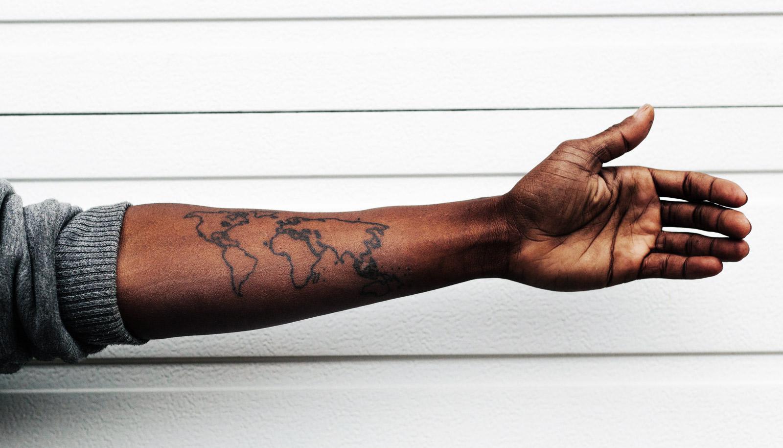 world map tattoo on arm - TIL maps