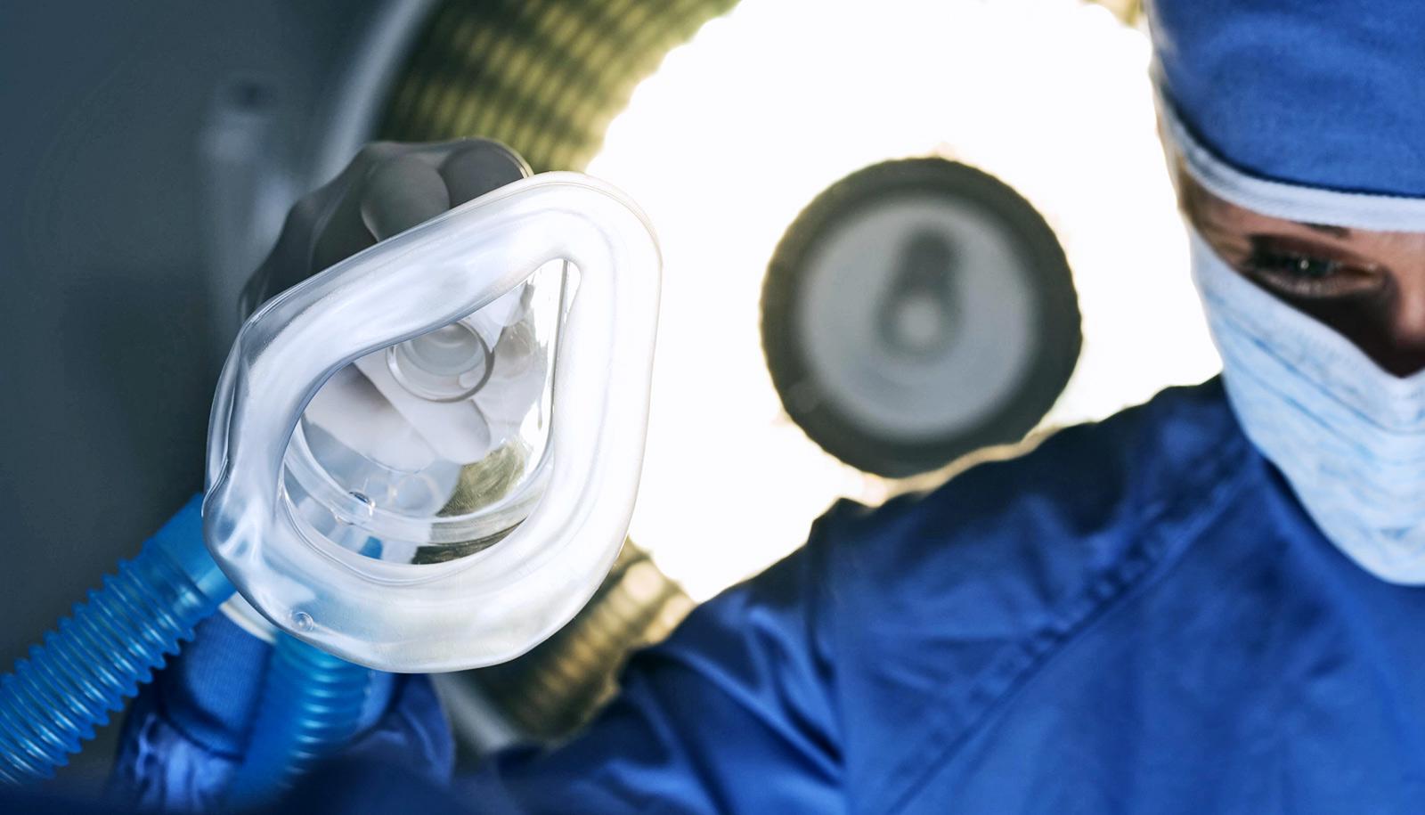 surgeon holding anesthesia mask