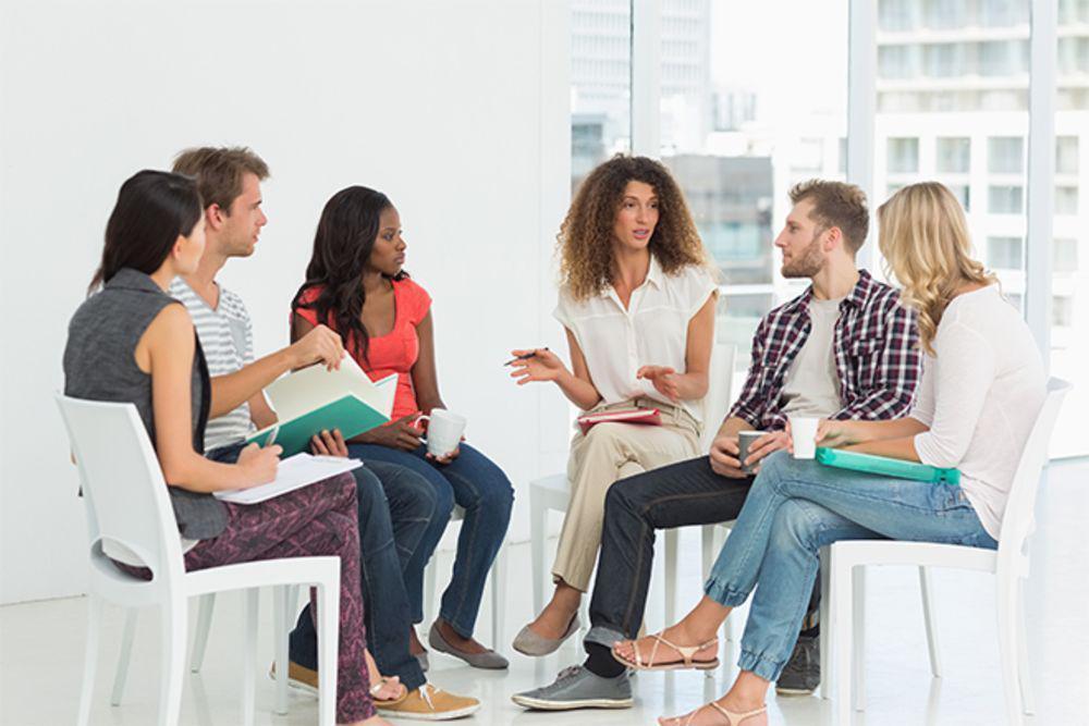 Therapist speaks to patients.