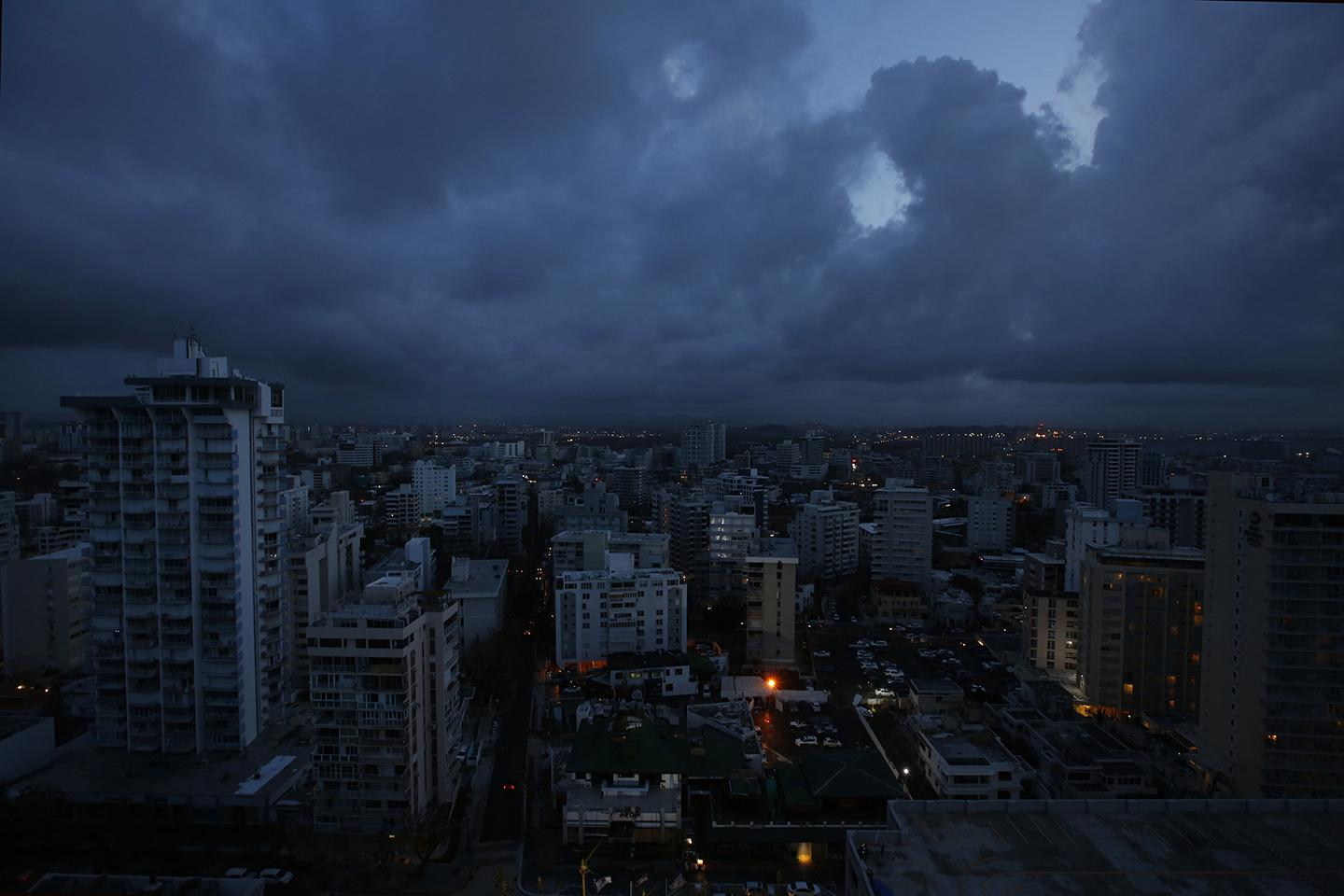 Downtown San Juan is cast in darkness on September 28, 2017. Any building with light was running off a generator, as there was no public electricity working on the whole island.