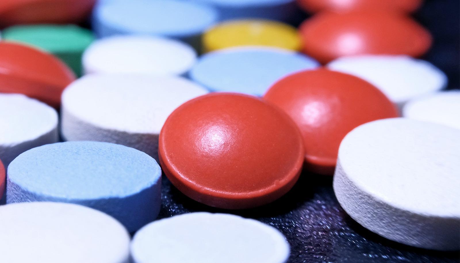 pills on dark background