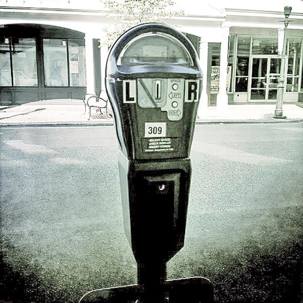 Be a Meter Feeder In Parking Lots (and Life): Finding Extraordinary in Ordinary, by Kristen Noel. Photograph of parking meter by Bill Miles