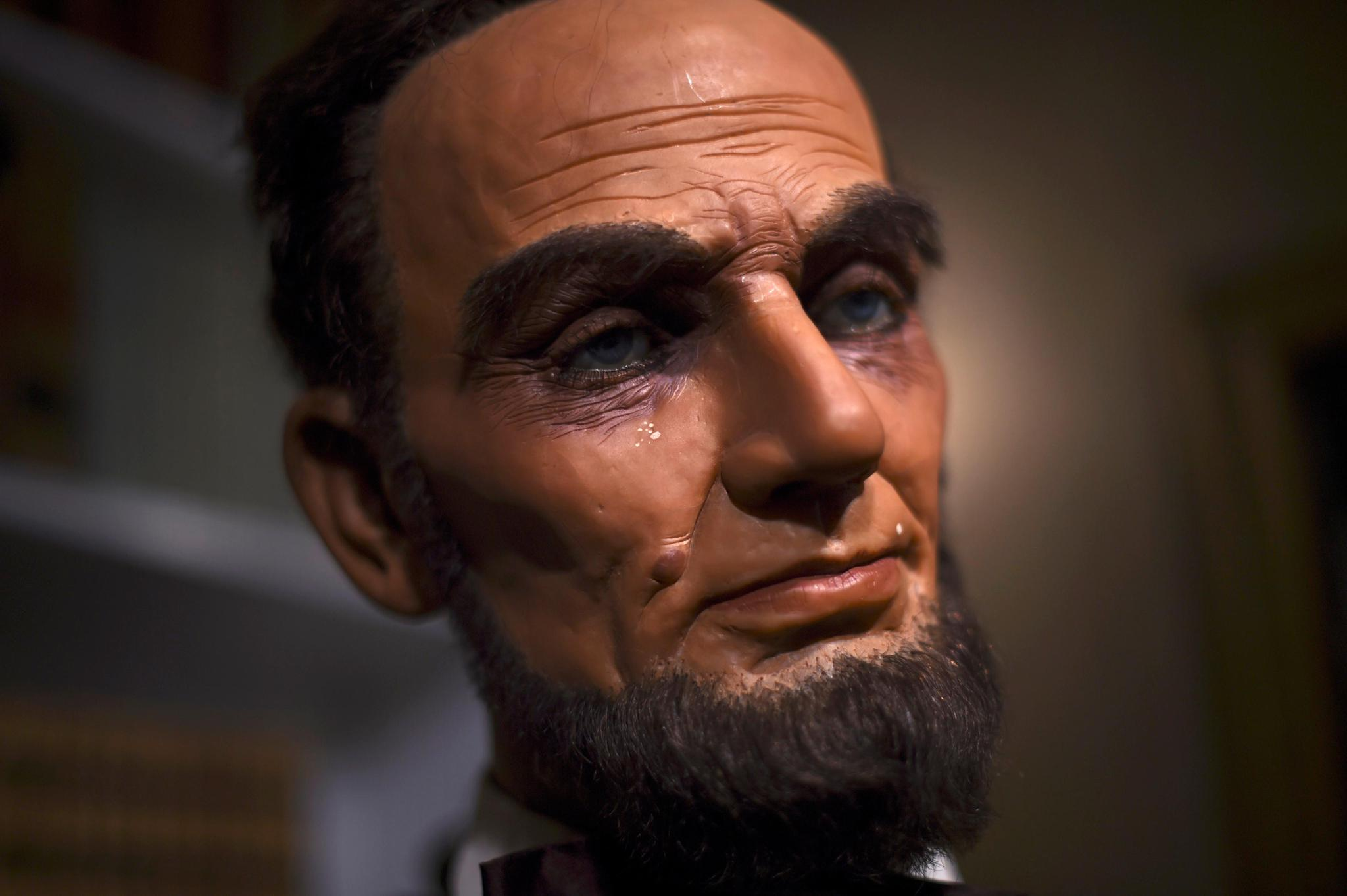 A wax figure of President Abraham Lincoln that sold for $9,000 at an auction of the Hall of Presidents Museum which closed in November 2016. With today's medical care, Abraham Lincoln may have survived his gunshot wound, says one trauma specialist.