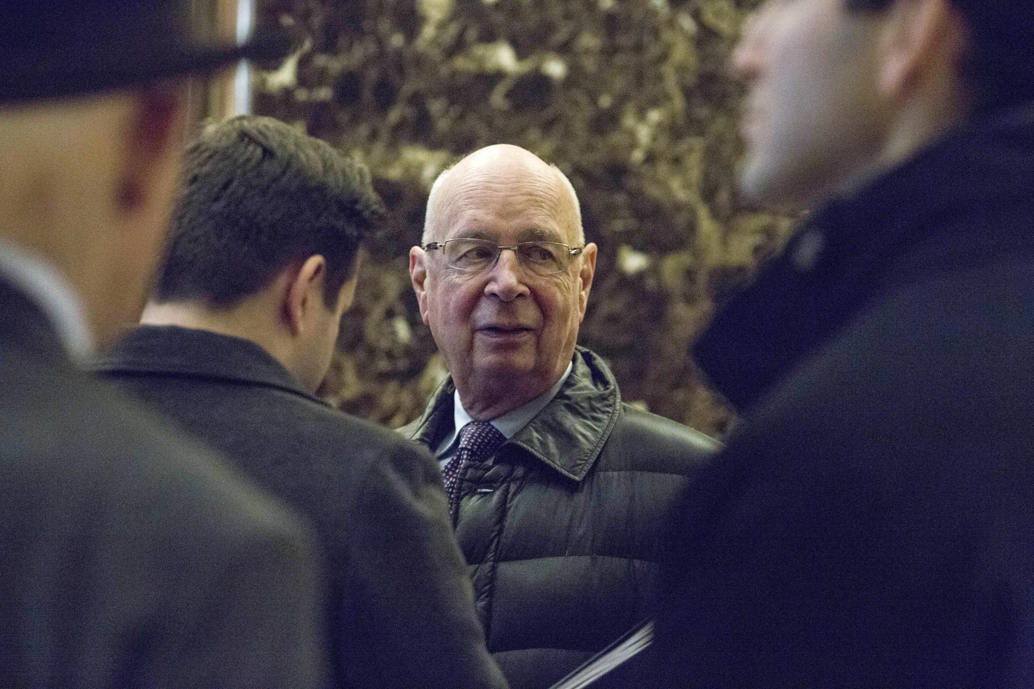 Klaus Schwab, executive chairman of the World Economic Forum (WEF), arrives in the lobby of Trump Tower in New York on December 13, 2016. Schwab was invited to a meeting with Trump.