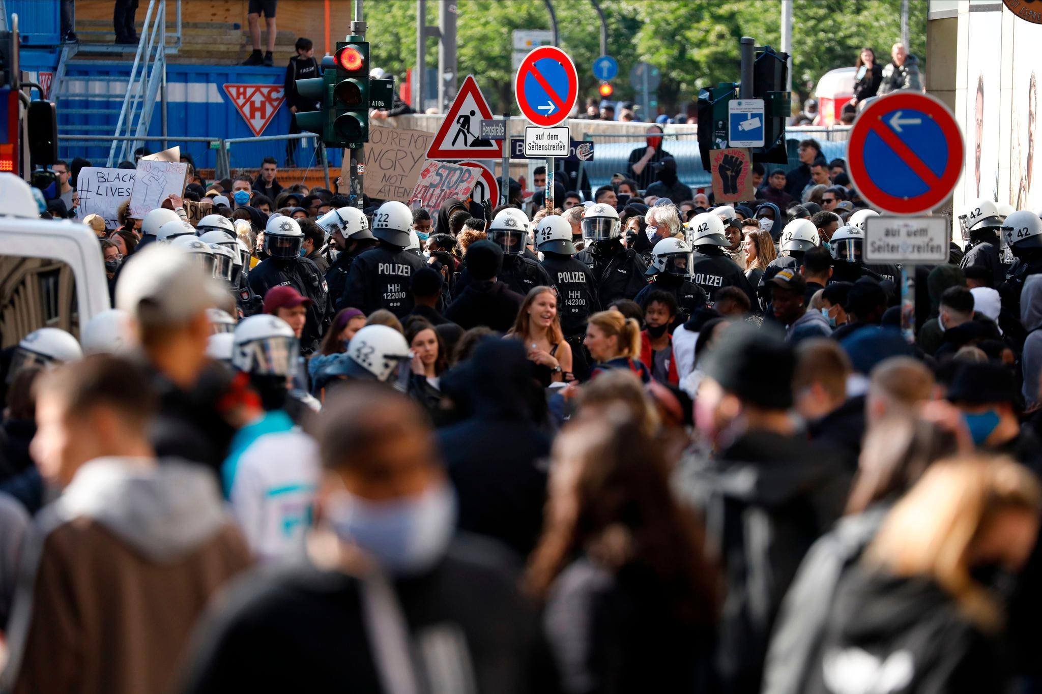 <p>Police stands guard during a BLM protest on June 6 in Hamburg</p>AFP via Getty Images