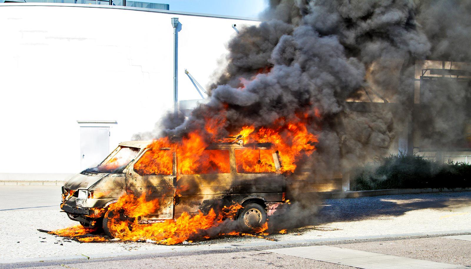 car on fire - armed conflict